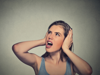 Woman unhappy covering ears